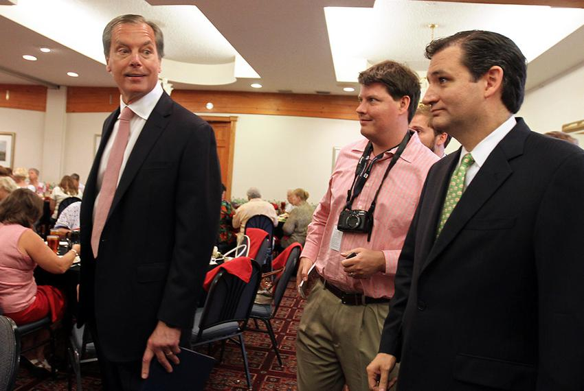Lt. Gov. David Dewhurst and Ted Cruz, who are competing in a run-off for U.S. Senate, speak to reporters before talking at t…