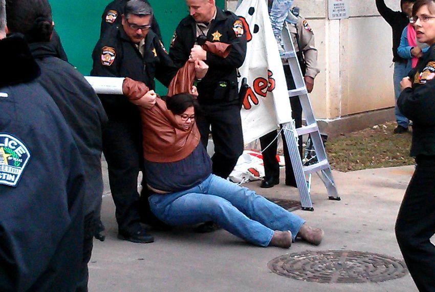 Cristina Parker gets arrested during a protest against the Secure Communities program.