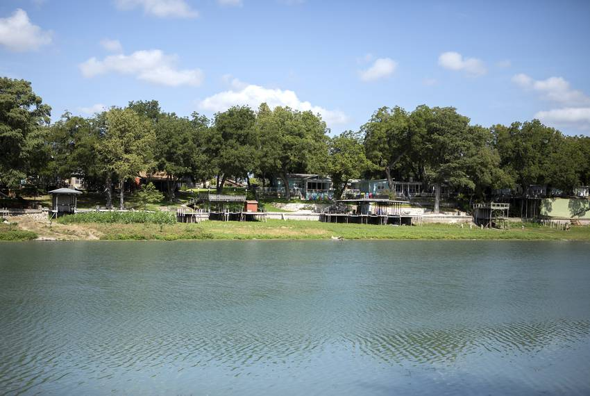 A row of boat launches sit over land on Lake Dunlap on Aug. 30, 2019. The structures used to sit over the lake until a rec...