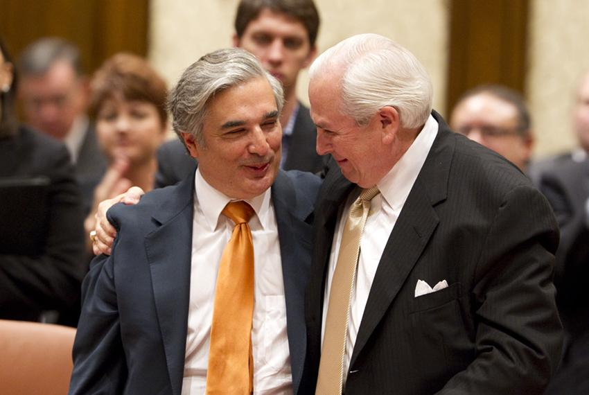 University of Texas System Chancellor Francisco Cigarroa (left), is congratulated by Gene Powell, chairman of the UT System …
