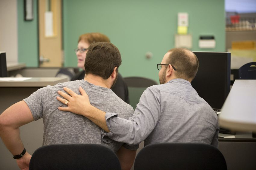 A couple arranges a marriage license at the Travis County Clerk's office on June 26, 2015.