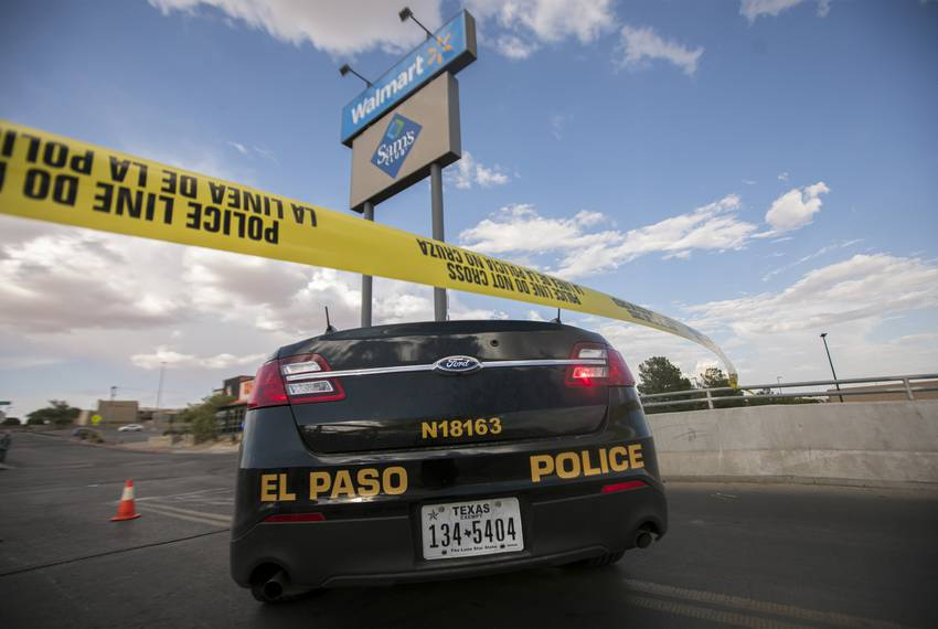 A police unit is seen at the back entrance to the Walmart where a gunman opened fire on back-to-school shoppers, Saturday,...