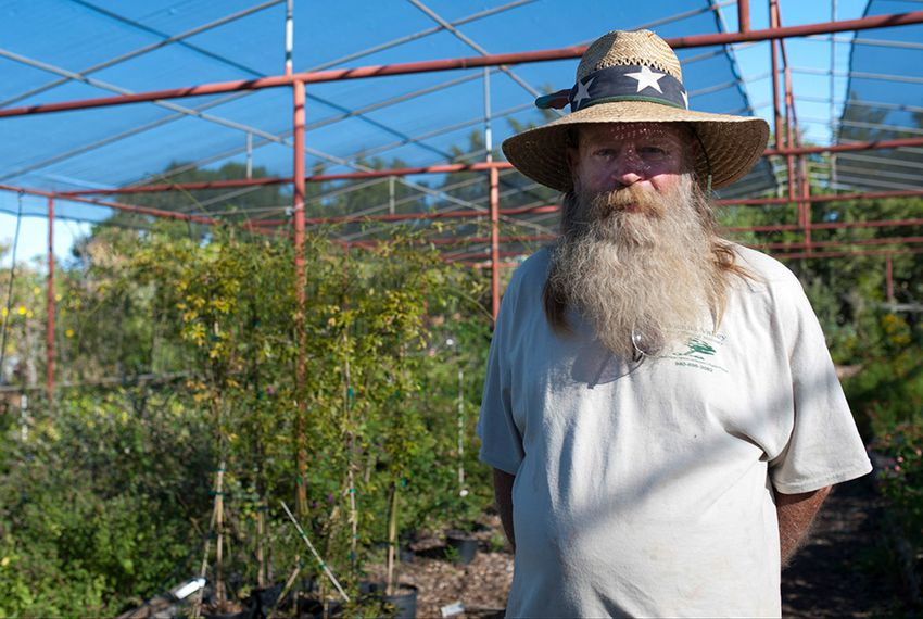 Paul Dowlearn poses for a portrait at Wichita Valley Nursery in Wichita Falls on Oct. 7. Dowlearn has been collecting rain water for years.