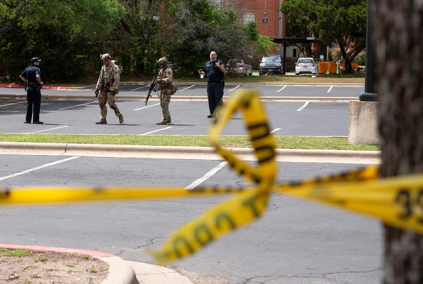 Law enforcement personnel investigate the scene of a deadly shooting at an apartment complex in Austin on April 18, 2021.  S…