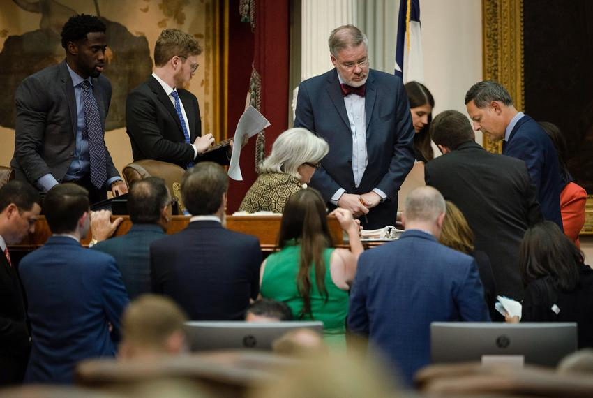 House members converge to discuss a point of order during a late-night session at the Capitol on Oct. 18, 2021.