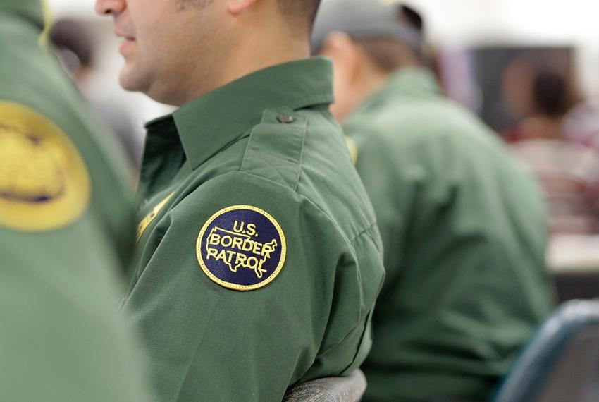 U.S. Customs and Border Protection agents at a processing facility in Brownsville on June 18, 2014.
