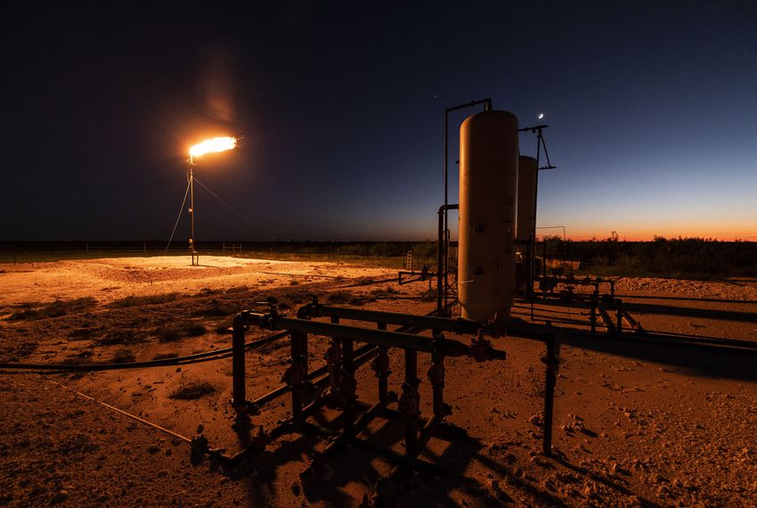 An oil well flare outside Midland in West Texas burns off natural gas, a process that pumps out pollutants and greenhouse gases.