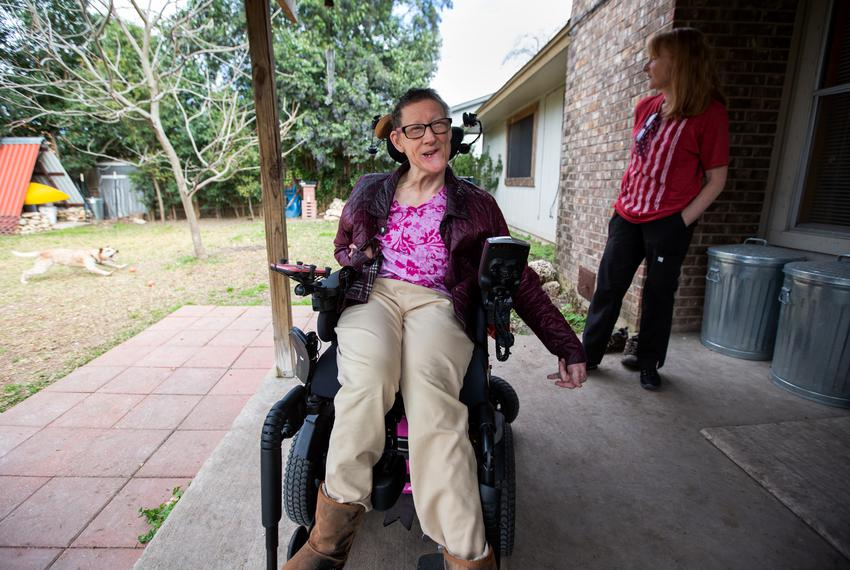 Susie Angel on the back patio of her home with her attendant Sandy White in Austin on Jan. 30, 2019.