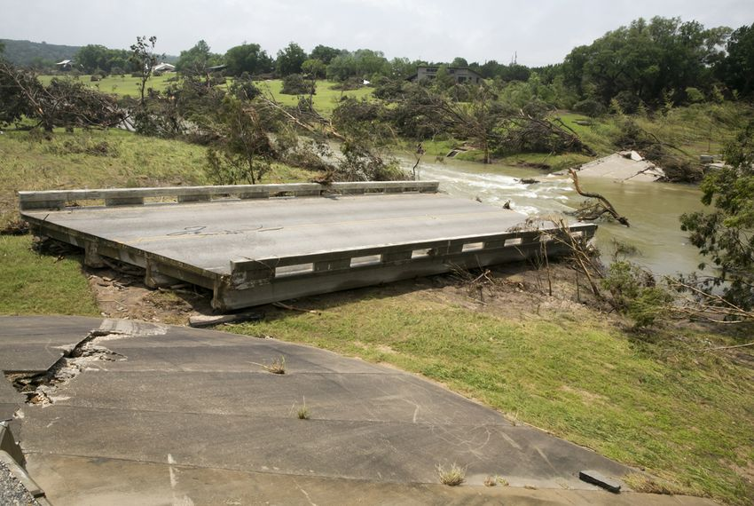A destroyed bridge over the Blanco River near Fischer Store Road near Wimberley, Texas, is shown on May 27, 2015.