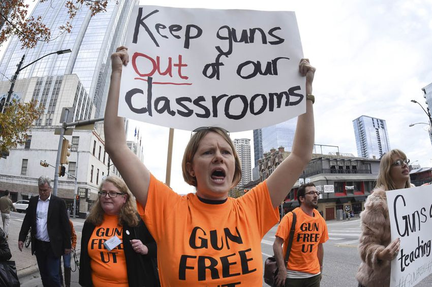 Stephanie Odam of Austin advocates for a gun-free learning environment during a Modern Language Association-sponsored march on Congress Avenue Jan. 8, 2016.