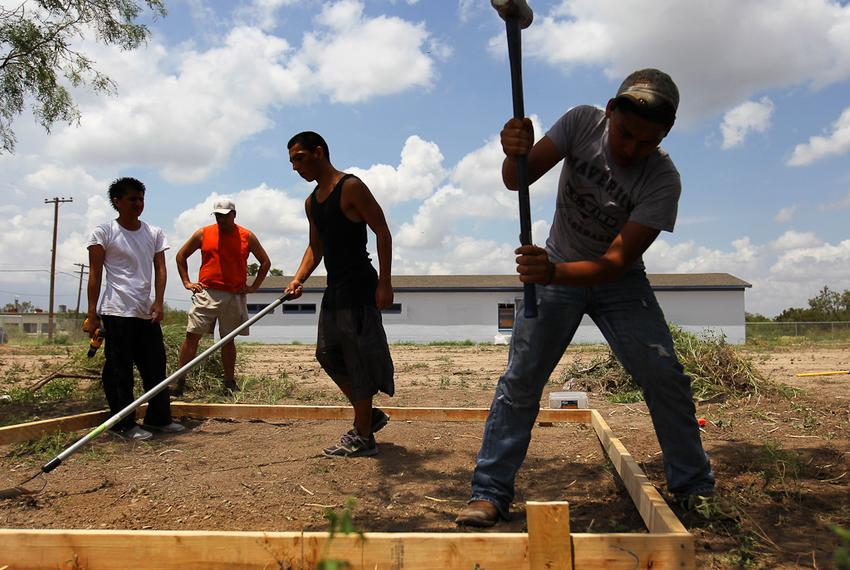 Juvenile detainees work on a new juvenile detention village in Eagle Pass. Maverick County has been taking donations for t...