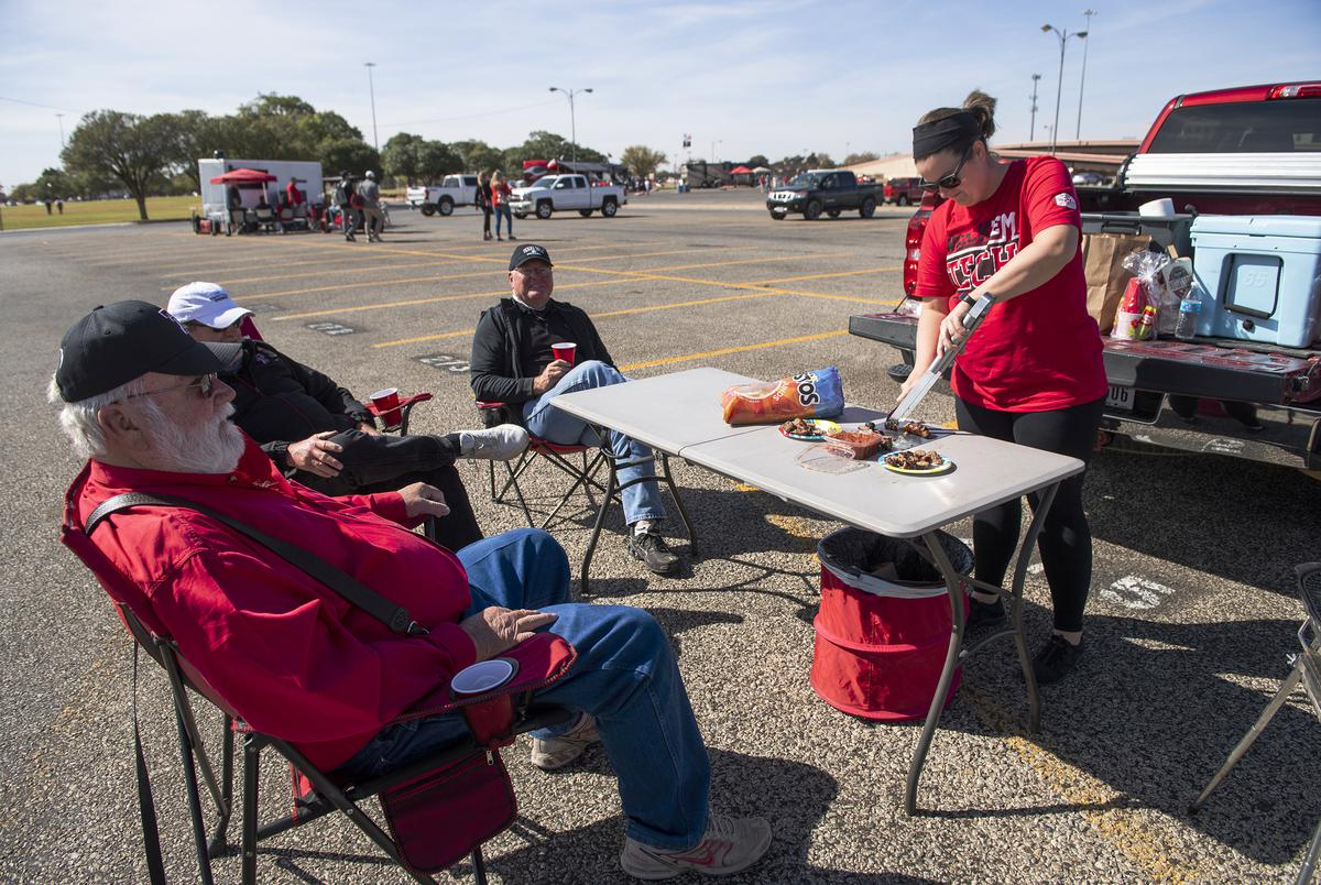 Aaron Ramsey prepares food for family and friends at their tailgate party before Texas Tech's home coming game against West Virginia at Texas Tech University on Saturday. Oct. 24, 2020.