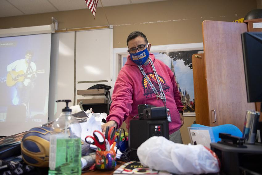 World history teacher Paul Chapa cleans out his classroom at Judson High School for the first time since spring break on Tue…