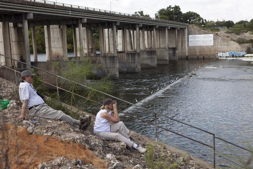 Birdwatchers Frank and Jane Lynn sit near Longhorn Dam, the last dam in the Texas Highland Lakes reservoir system before the…