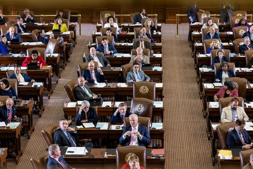 Lawmakers at their desks on the House floor on May 30, 2021.