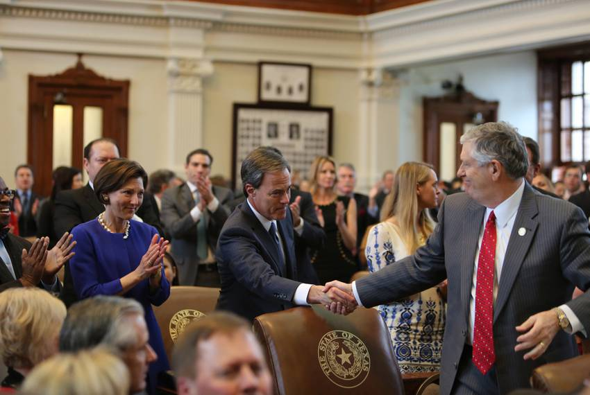 House Speaker Joe Straus shakes hands with state Rep. Paul Workman, R-Austin, on the first day of the 84th Legislative Ses...