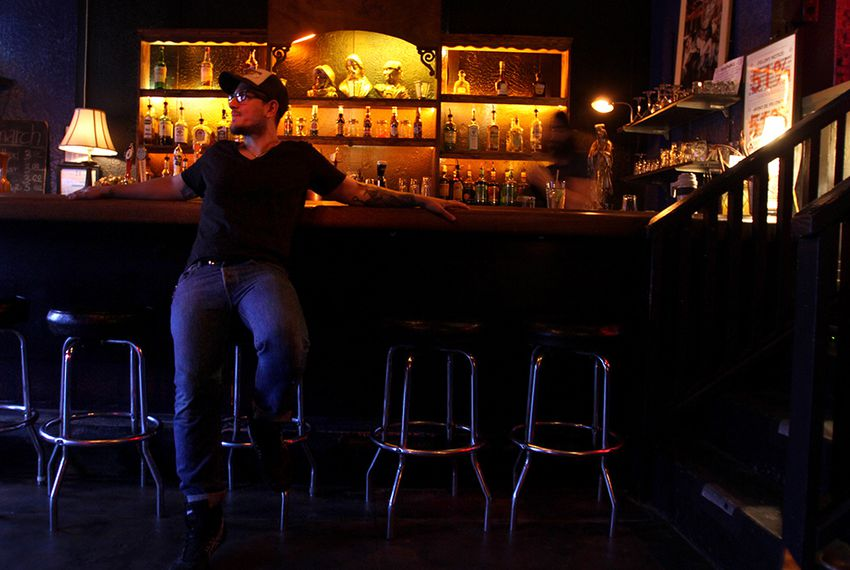 Alfred Campos waits for the Monday night karoake crowd to trickle in to his bar Monarch in El Paso, Texas.