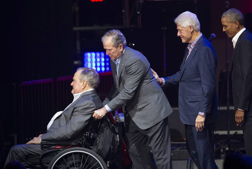 Left to right: Former Presidents George H.W. Bush, George W. Bush, Bill Clinton and Barack Obama at a hurricane relief in ...