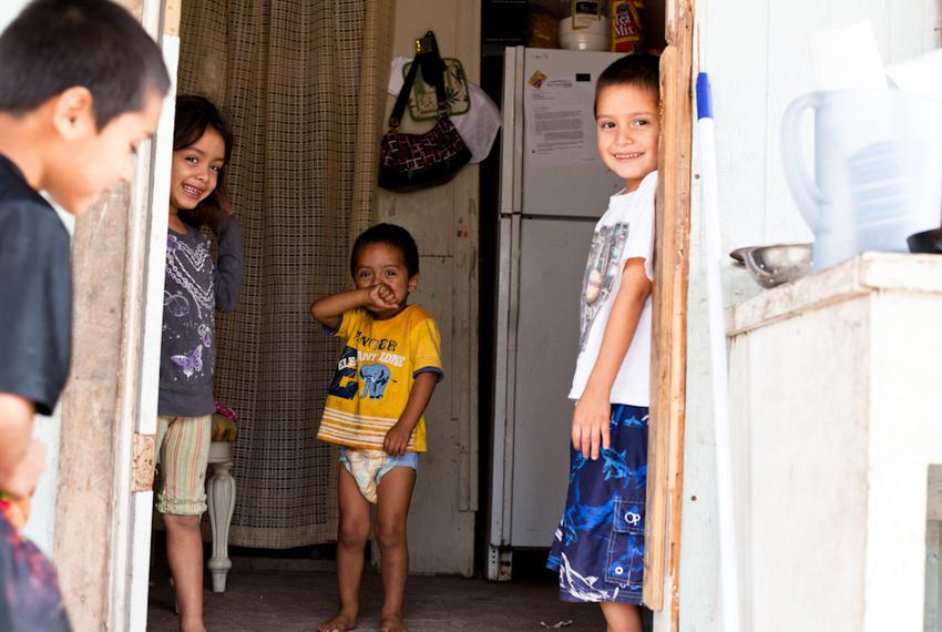 Four of the five children who live in this dilapidated one-room home in Mexico Chiquito, a colonia in the Rio Grande Valley.