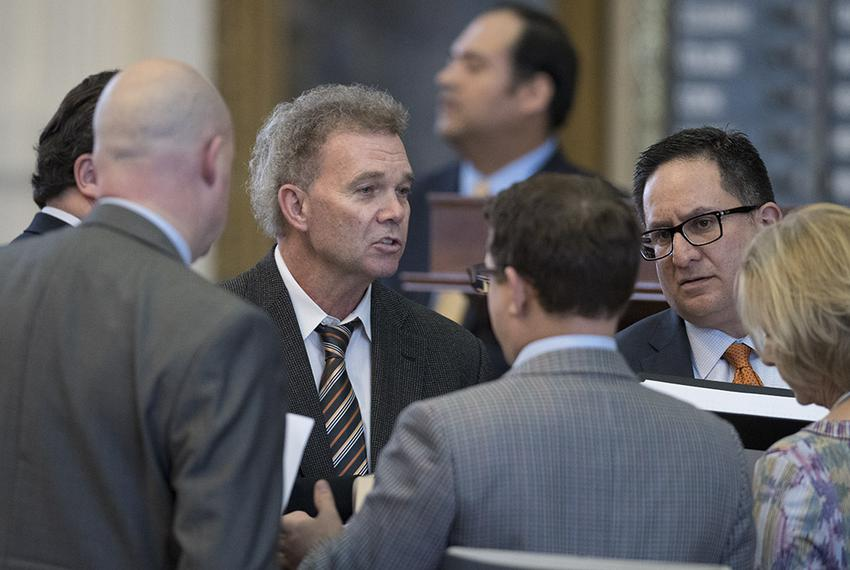 State Reps Joe Pickett, D-El Paso, and Larry Gonzales, R-Round Rock, negotiate with House members with amendments to SB 31...