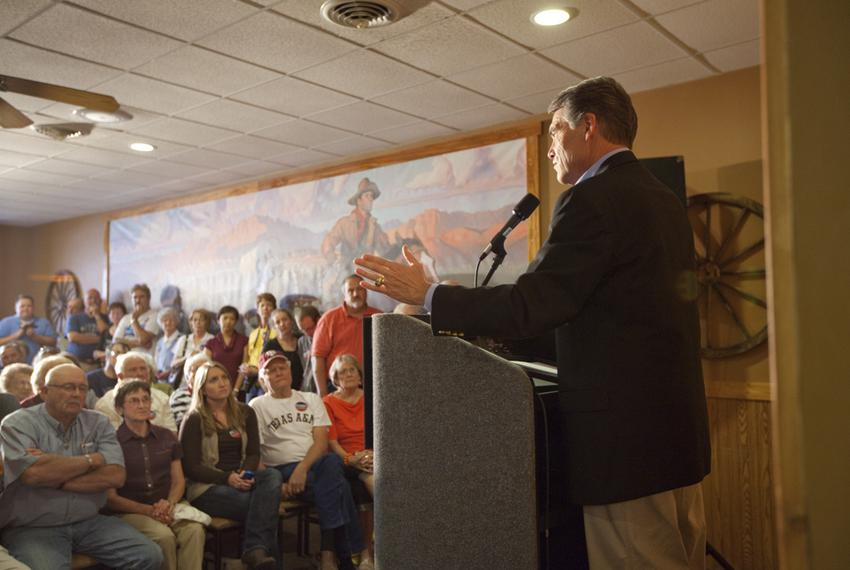 Gov. Rick Perry speaks at Pizza Ranch in downtown Spencer, Iowa, on Oct. 8, 2011.