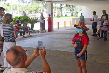 Jon West takes a photo of his daughter Emma, 5 at the annual Fourth of July reading of the Declaration of Independence at the Nueces County Court House in Corpus Christi.