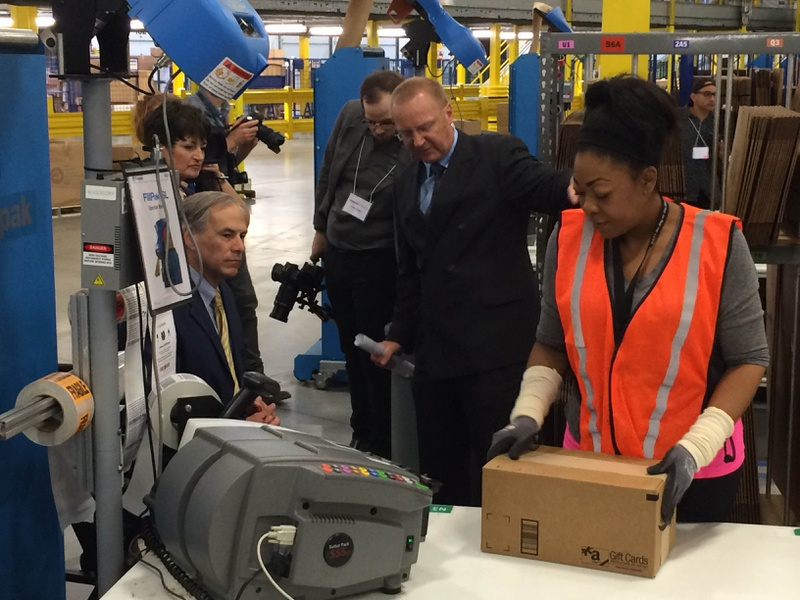 Gov. Greg Abbott tours Amazon's new distribution center Friday outside San Antonio. The hub in Schertz is one of three in Texas.