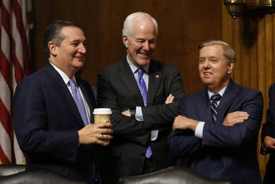 Republican Sens. Ted Cruz, John Cornyn and Lindsey Graham during a break in the hearing on the nomination of Brett Kavanaugh to be an associate justice of the Supreme Court of the United States, on Capitol Hill in September 2018.