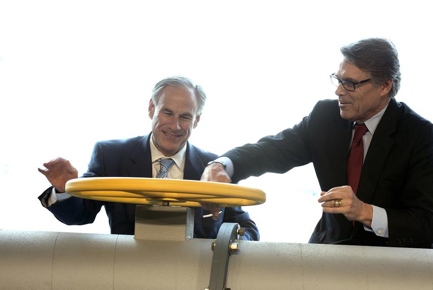 Texas Gov. Greg Abbott, left, and Secretary of Energy Rick Perry join the Petra Nova carbon capture and enhanced oil recover…