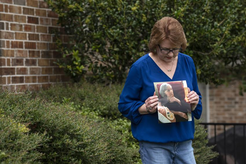 Genny Lutzel holds a photograph of her mother, Paula Spangler, 80, outside her home in Rockwall on Aug. 06, 2020. Lutzel h...
