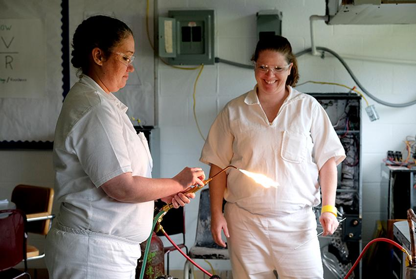 Kathleen Nicole Gillespie, left, and Amber Kenyon take an HVAC class at the Sycamore Satellite of the Crain Unit, a women'...