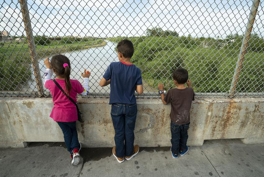 Javier Alejandro Vindel-Rodriguez (center) looks down at the Rio Grande with his siblings, Yenci (left) and Jesus Samuel o...