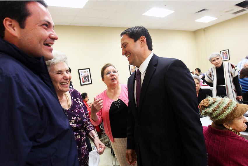 State Representative Trey Martinez-Fischer, right, and District 7 Councilman Justin Rodriguez, left, greet Rodriguez's gra...