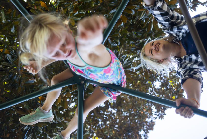 Eight-year-old Sunny Bryant climbs on a dome at her Waldorf-inspired school as her mother Rebekah looks on, in Houston on Se…