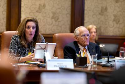 Vice Chairman James D. Dannenbaum, right, and Regent Brenda Pejovich, left, at the Board of Regents meeting for The University of Texas System on Feb. 14, 2013.