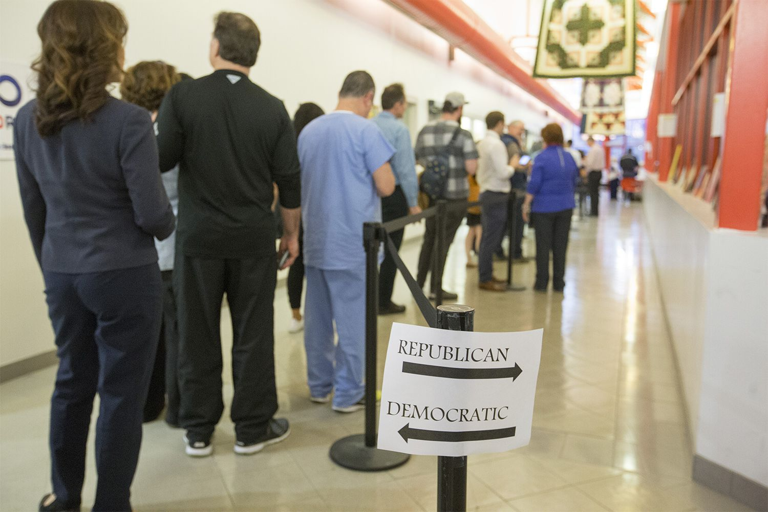 A long Democratic line and an empty Republican line as voters arrive to the polls in the last hour of the primaries near downtown Houston on Tuesday, March 6, 2018.