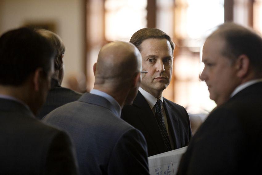 House Speaker Dennis Bonnen and State Rep. Dustin Burrows, R-Lubbock, meet on the house floor.