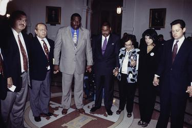 Photos COPYRIGHT Bob Daemmrich 1997, 1999, 2001.  All rights reserved. Sen. Royce West in action at the Texas Senate. Year is shown in the file name.  Praying with Sen. Carlos Truan and Rodney Ellis and Irma Rangel.  Mario Gallegos on the left.