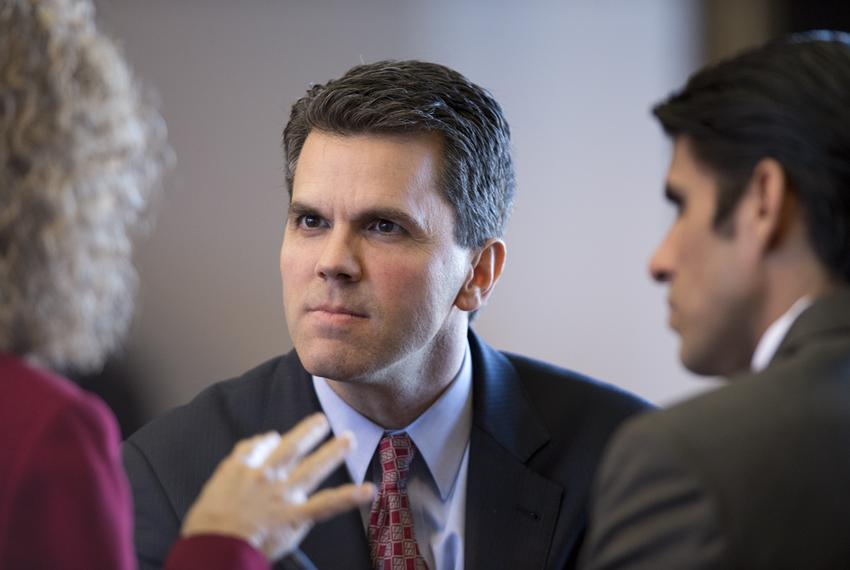 State Rep. Mark Strama, D-Austin, talks with colleagues in the Texas House on Feb. 13, 2013. Strama announced that he's no...