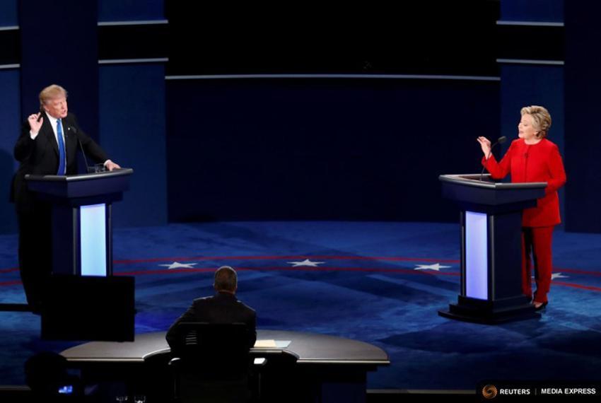 Republican U.S. presidential nominee Donald Trump and Democratic U.S. presidential nominee Hillary Clinton during their fi...