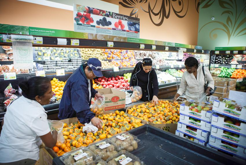 Shoppers who identified themselves as Indian, Filipino, Egyptian and Jamaican, check out the stock of persimmons at the 99 R…