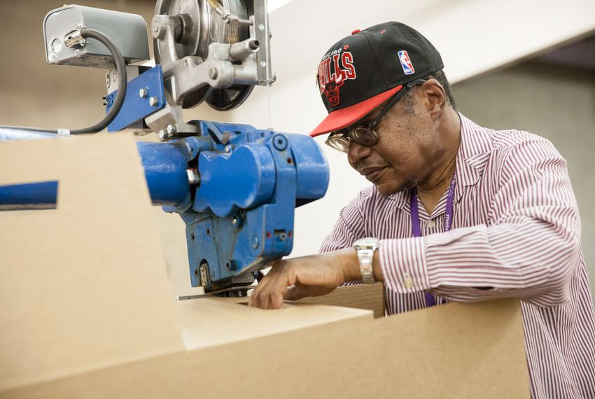 Leonard Mitchell staples box seams for a state-contracted order at Expanco, Inc. in Fort Worth on Feb. 20, 2015. Photo by: Laura Buckman