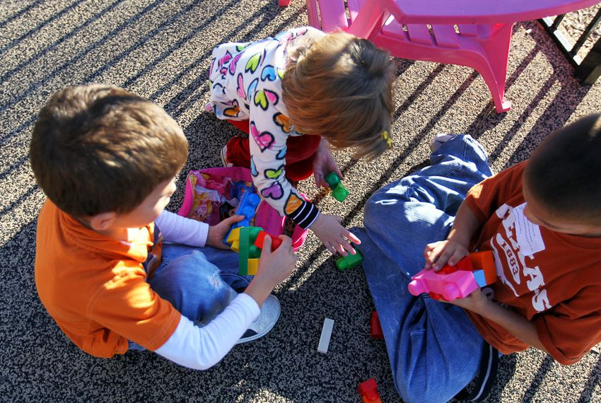 Children play on the outdoor playground.