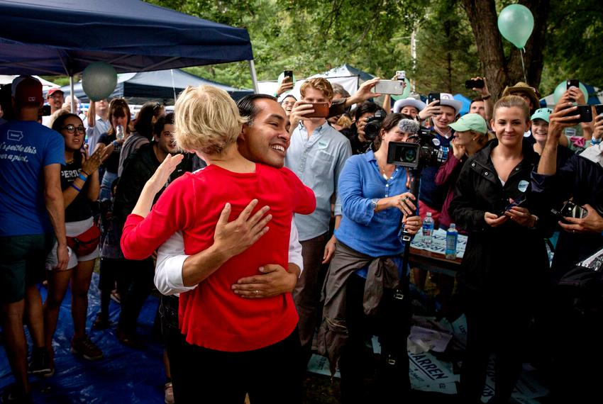 Presidential candidates Julián Castro and Massachusetts Senator and Elizabeth Warren hug as they meet supporters during th...