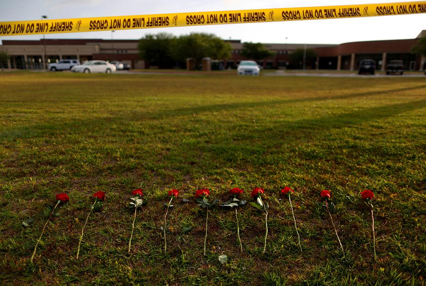 Ten roses left in memory of the victims killed in a shooting at the Santa Fe High School in Santa Fe on May 20, 2018.