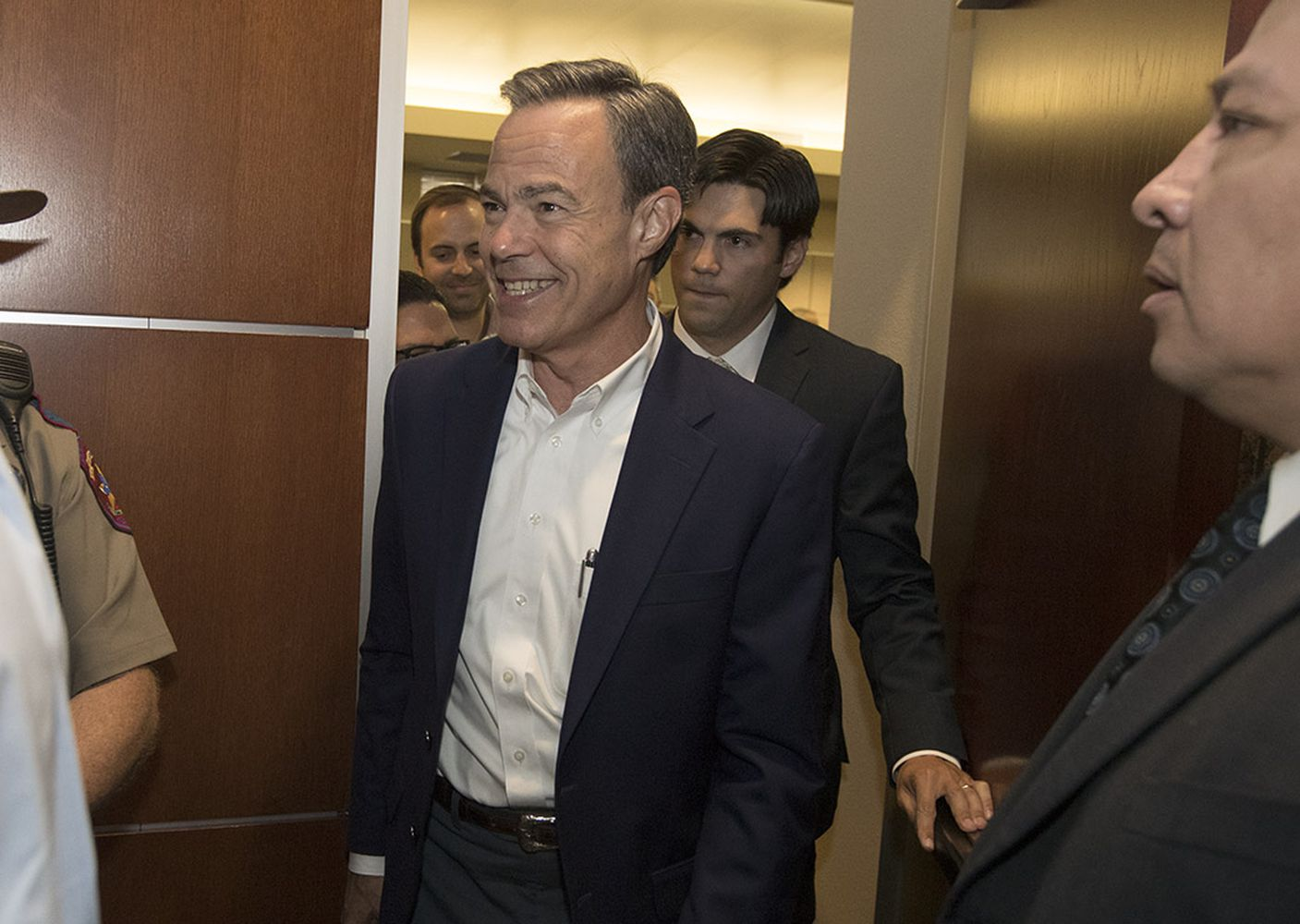 House Speaker Joe Straus, R-San Antonio, emerges smiling from a caucus of Republican members after the 85th Legislature adjourned sine die on Aug. 16, 2017.