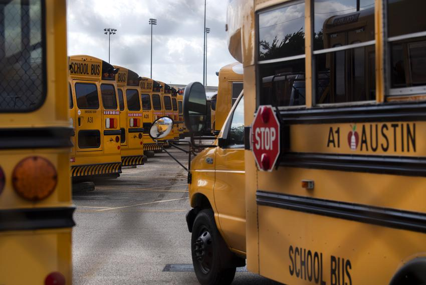 School buses are parked at the Austin Independent School District bus center in July.