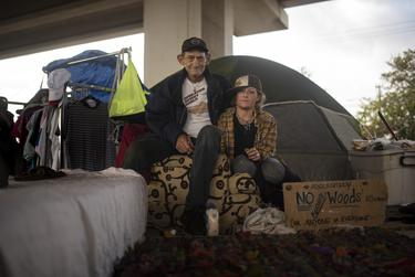 Herman Rux, left, had been homeless in the late 1980s but now visits encampment sites to visit friends such as Harvest, right who lives under the TX-71 and W. Ben White Blvd. overpass. This portrait was taken on Oct. 24, 2019.