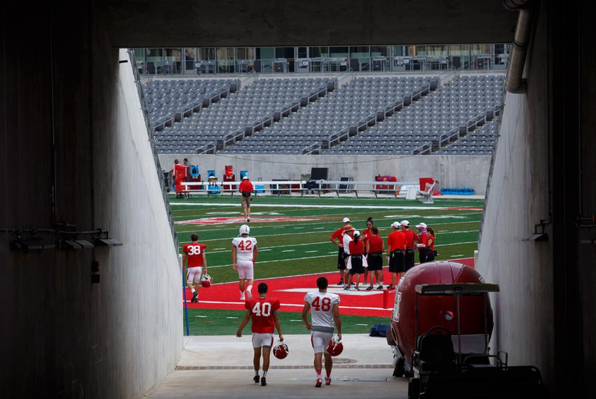 Football players practice at TDECU Stadium at the University of Houston on Aug. 28, 2015.