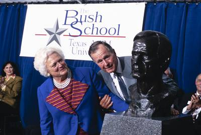 Former President George H.W. Bush and wife Barbara in 1997 at the dedication of the Bush School of Government and Public Service at Texas A&M University. |